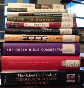 a stack of books on theology, gender, and sexuality